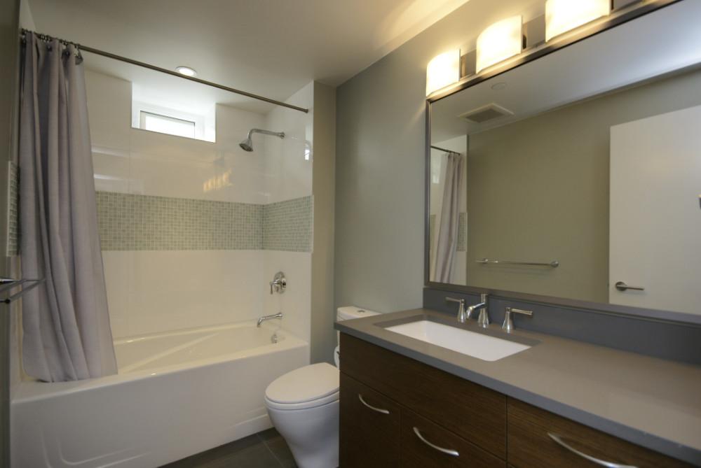 W 49th Ave-contemporary -modern-bath-tub-white tile (2)