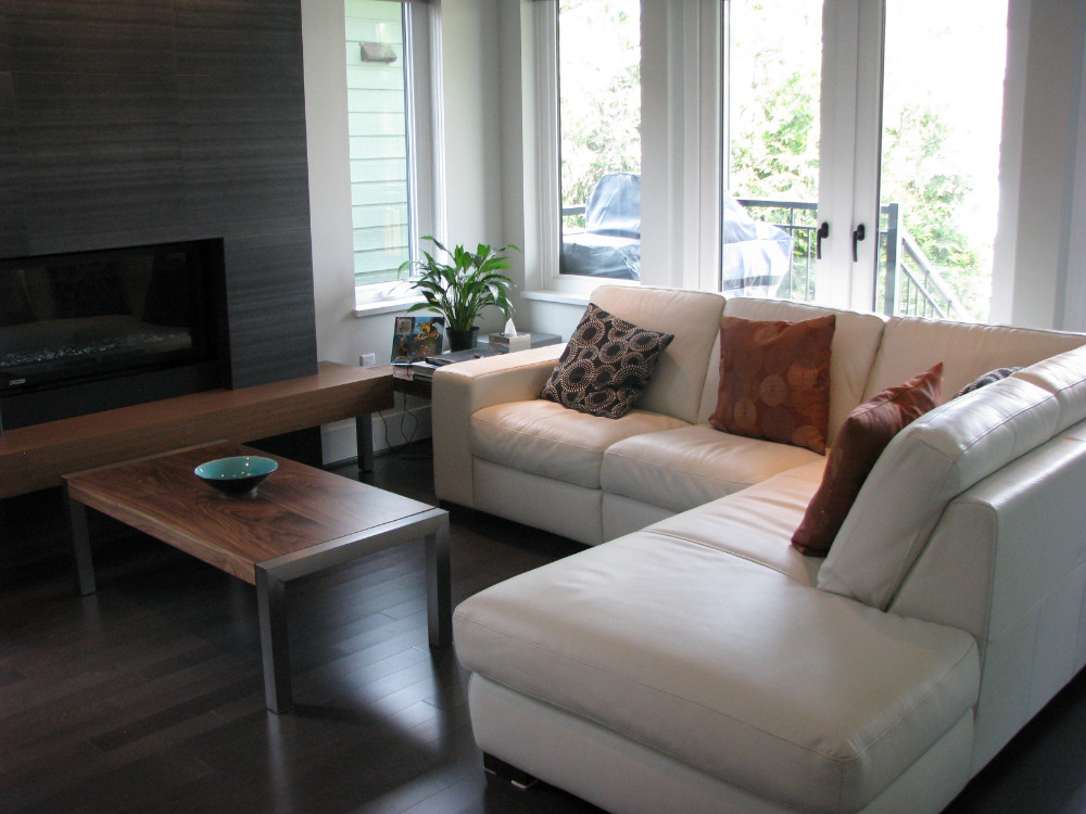 W 49th Ave-contemporary -modern-living room-tile fireplace-floating wood hearth-white sectional (2)