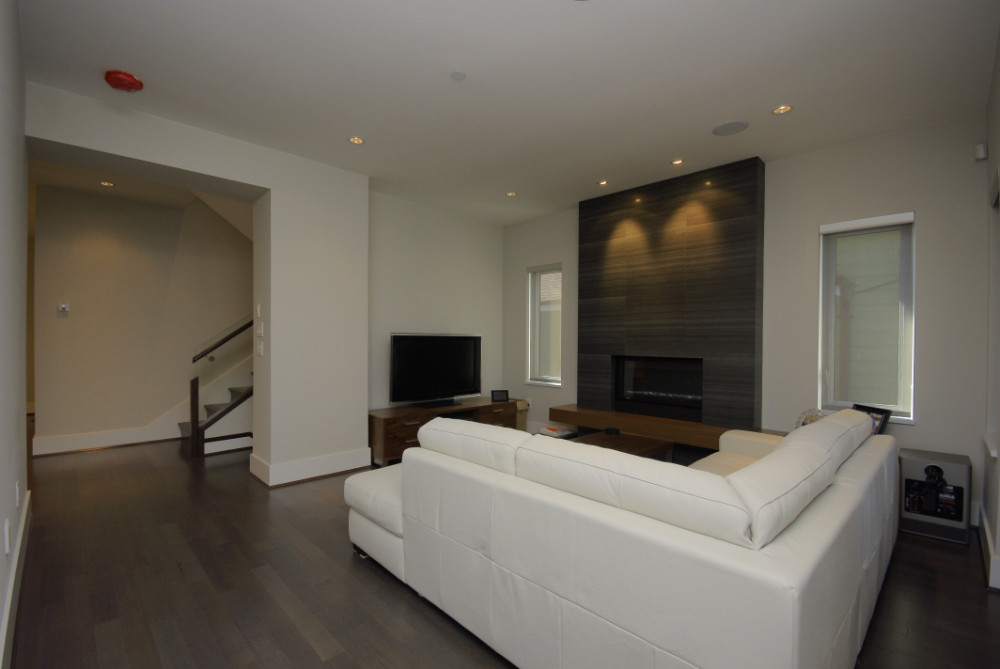 W 49th Ave-contemporary -modern-living room-tile fireplace-floating wood hearth-white sectional (3)