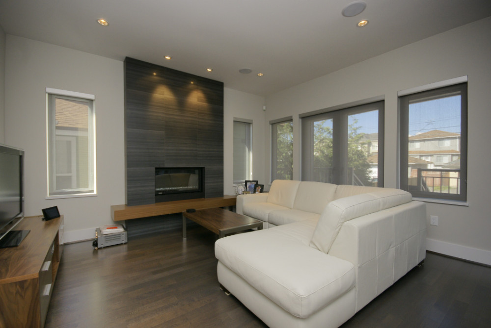 W 49th Ave-contemporary -modern-living room-tile fireplace-floating wood hearth-white sectional (4)